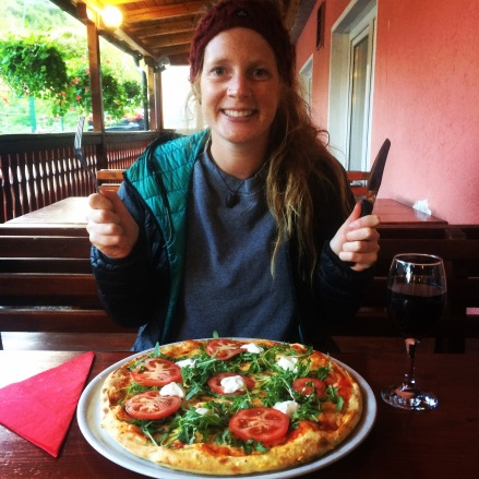 Enjoying a veggie pizza